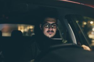 graphicstock young handsome man using smartphone in his car at night dangerous technology driver concept_H6lLjnNc1  300x200