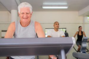 people and sports elderly man working out on treadmill in fitness gym among young peop SBI 310156706 300x200